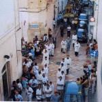 Anni '90 . processione della Madonna del Carmine in via Maddalena. Avanti al  Sacro quadro il parroco don Giovanni D'Arienzo