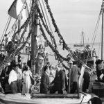 Maggio 1954-La Madonnina Stella Maris- sul motopeschereccio -C1- della Socopesca di Manfredonia-Sulla poppa il gen. R.Castriotta-prof. M. Garzia e M. Capurso-pescatore